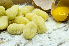 Making gnocchi with flour and eggs stock photo