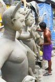 Making of Goddess Durga. Indian pottery artist making idols of Goddess Durga at Kumartuli from northern Kolkata,India. For generations, the inhabitants of royalty free stock image
