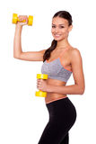 Making good progress. Portrait of a smiling young woman lifting weights against white isolated background Royalty Free Stock Photos