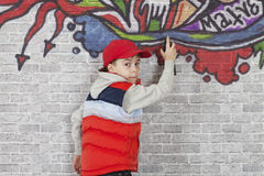 Making Graffiti on a brick wall Stock Image