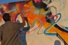 Making Graffiti. Man spraypainting graffiti at Peninsula festival, Tg.-Mures, Romania Royalty Free Stock Photo