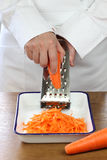 Making grated carrot salad, shredding carrots Stock Photos