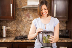 Making green juice in a blender Royalty Free Stock Image