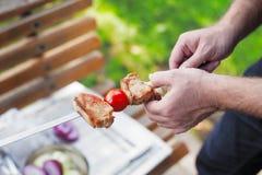 Making Grilled meat on sticks (shashlyk) Royalty Free Stock Photography