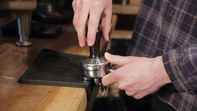 Making ground coffee with tamping fresh coffee. Professional barista. stock video footage