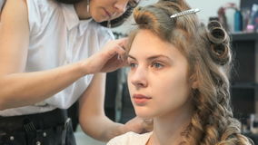 Making of hairstyle volume for the model girl stock video