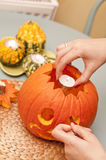 Making of halloween pumpkin lantern Royalty Free Stock Image