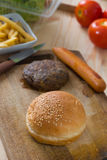 Making hamburger fast food ingredients with plenty of raw materi Royalty Free Stock Photography