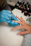 Making hand nails in a professional hand care salon - manicure Royalty Free Stock Images