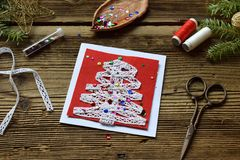 Making of handmade christmas greeting card from felt with your own hands. Children& x27;s DIY concept. Making xmas decoration stock photo