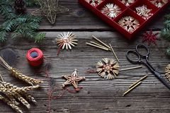 Making of handmade christmas toys from straw with your own hands. Children's DIY concept. Making xmas tree decoration.  royalty free stock photos
