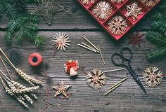 Making of handmade christmas toys from straw with your own hands. Children's DIY concept. Making xmas tree decoration.  stock image