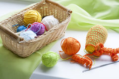 Making of handmade colorful crochet toys sweets (key ring) with skein on wooden table Royalty Free Stock Image