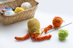 Making of handmade colorful crochet toys sweets (key ring) with skein on wooden table Royalty Free Stock Photos