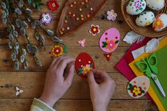Making of handmade easter eggs from felt with your own hands. Children DIY concept. Making Easter decoration or greeting card. Making of handmade easter eggs Royalty Free Stock Photos