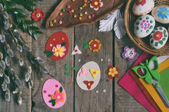Making of handmade easter eggs from felt with your own hands. Children DIY concept. Making Easter decoration or greeting card. royalty free stock photo