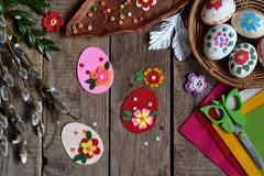 Making of handmade easter eggs from felt with your own hands. Children DIY concept. Making Easter decoration or greeting card.  royalty free stock images