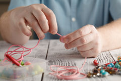 Making of handmade jewellery, front view of male hands Royalty Free Stock Photo