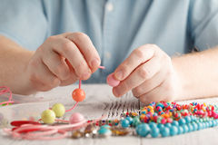 Making of handmade jewellery, front view of male hands Stock Photography