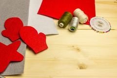 Making handmade toy toys from felt by one`s own hands. Children`s concept. Details for toys. Royalty Free Stock Images