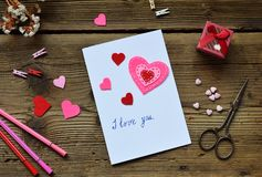 Making of handmade Valentine greeting card from felt. Children DIY, hobby concept, gift with your own hands. Valentine& x27;s Day royalty free stock images