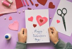 Making of handmade Valentine greeting card from felt. Childrens DIY, hobby concept, gift with your own hands. Valentine& x27;s Day stock images