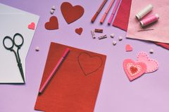 Making of handmade Valentine greeting card from felt. Childrens DIY, hobby concept, gift with your own hands. Valentine& x27;s Day royalty free stock photo