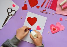 Making of handmade Valentine greeting card from felt. Childrens DIY, hobby concept, gift with your own hands. Valentine& x27;s Day stock photography