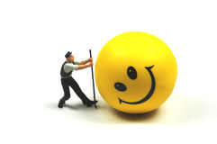 Making a happy face again. A workman is trying to make a happy face again Royalty Free Stock Photos