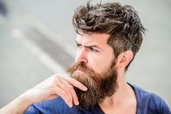 Making hard decision. Bearded man concentrated face. Thoughtful mood concept. Making important life choices. Man with. Beard and mustache thoughtful troubled stock image