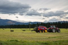 Farm machinery at work on a farm in New Zealand stock images