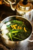 Making healthy kale and mushrooms soup Royalty Free Stock Images