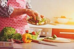 Making healthy vegetable salad Stock Image