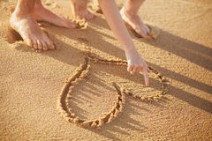 Making heart on the beach. Drawing heart on the beach  close up Stock Image