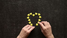 Making a heart from buttons stock footage
