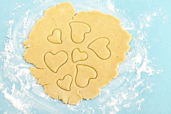 Making heart shaped shortbread cookies with cutter Stock Image