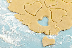 Making Heart Shaped Shortbread Cookies With Cutter Royalty Free Stock Photos