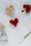 Making Heart Shaped Toast with Strawberry Jam for Valentine`s Day Breakfast Stock Images