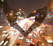 Making Heart Sign with Hands, Night View stock image