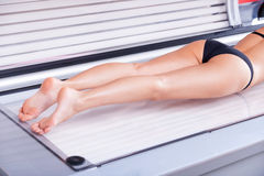 Making her beautiful body tanned. Royalty Free Stock Images