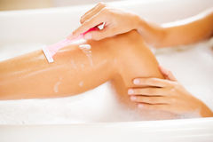Making her legs smooth. Royalty Free Stock Photos