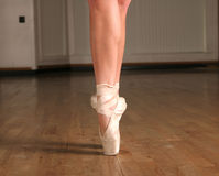 Making her point. Ballerina's legs and feet on a point Royalty Free Stock Images