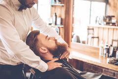 Making his beard look perfect. Royalty Free Stock Images