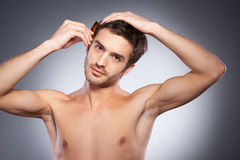 Making his hairstyle. Royalty Free Stock Images