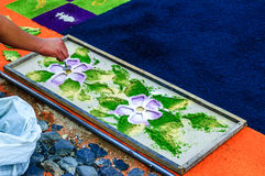 Making Holy Week processional carpet, Antigua, Guatemala. Antigua, Guatemala - April 2, 2015: Making Holy Week processional carpet (alfombra) using wooden royalty free stock image