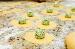 Making home-made ravioli pasta. From scratch with goat cheese and arugula stuffing Stock Photography