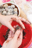 Making homemade chocolate candies with nuts and waffles flakes Royalty Free Stock Images