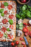Making Homemade classic margherita pizza Stock Photography