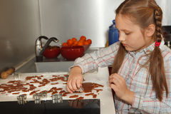 Making homemade gingerbread for christmas Royalty Free Stock Image