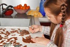 Making homemade gingerbread for christmas Stock Image
